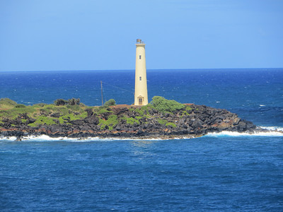 Playing with my zoom lens to photograph this little lighthouse.  Not bad!