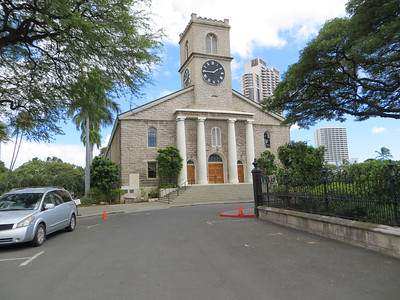 """Next to Lunalilo's tomb is Kawaiaha'o Church.  It was begun in 1837, built largely by Hiram Bingham, the leader of the early missionaries, out of giant coral slabs.  My guidebook says that divers """"ravaged the reefs"""" to get the coral, some pieces of which weighed more than 1,000 pounds, and caused irreparable environmental damage in doing so.  It is Hawai'i's oldest church and was the site of many historic events.  Sunday services (in Hawaiian, according to the guidebook) are still held there every week at 9:00am."""
