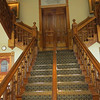 The incredible main staircase is made of koa wood.  Based on what people said about how expensive it is now, we're probably looking at a million-dollar staircase!