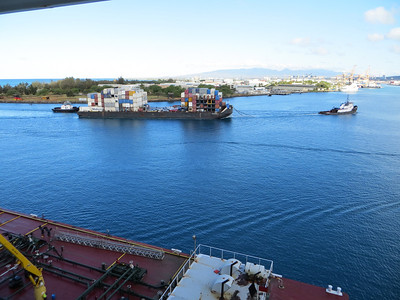 I watched tugboats escorting this barge.