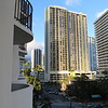 Because we made our hotel reservations through Norwegian Cruise Lines when we reserved the cruise itself, the package included transportation to our hotel--again, the Marriott Waikiki Beach.  Our room this time was pretty close to the one we had before the cruise.  This was the view in one direction from our balcony.  The little light green roof in the bottom right corner is at the bus stop where we got the bus for our expeditions.  Honolulu has a very good bus system and senior citizens only pay $1.00 if you show your Medicare card.