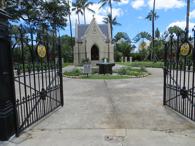 """From the Iolani Palace we walked to an area that was devoted to the early missionaries who came to the """"Sandwich islands"""" starting about 1820.  First, however, we stopped at the tomb of King Lunalilo.  He was chosen to be king by the legislature in 1873, because the hereditary line of succession had petered out.  Unfortunately he died little more than a year after becoming King.  He asked for his tomb to be here rather than in the traditional burying place for Hawaiian kings."""