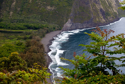 the view from the road going down into the valley. this is one of the black sand beaches of Hawaii