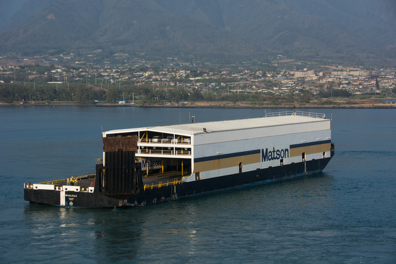 Autos and containers coming to port.
