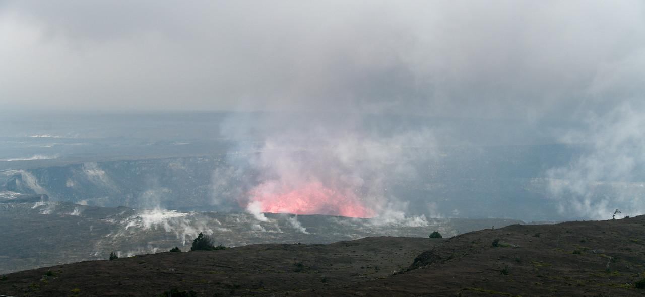 Late day lava glow from Halema'uma'u Crater inside the Kilauea Caldera at Volcanoes National Park, HI - March 2018