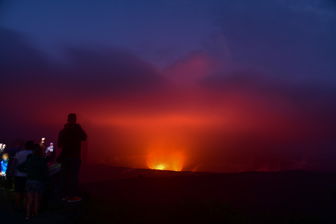 30 second exposure of tourists viewing the lava glow from the Halema'uma'u Crater (inside Kilauea Caldera) at Volcanoes National Park, HI - March 2018