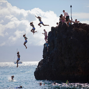 Jumping from Black Rock in Maui.  This is a sequence of 5 photos pieced together in Photoshop.