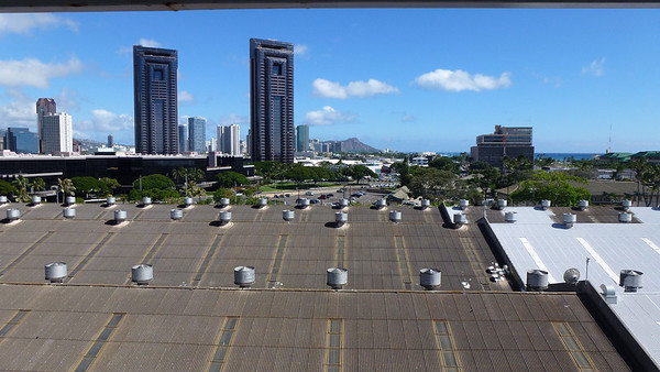 View from our balcony of our Cruise ship (Pride of America) in the Honolulu port. (You can see Diamond Head in the distance.)