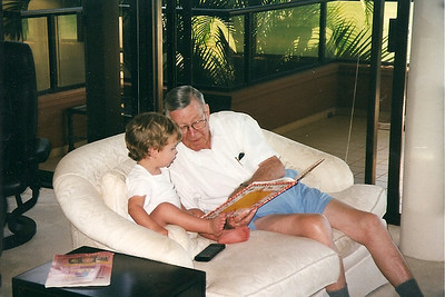 Caleb's Great-Granddaddy reading to him in Hawaii    1998