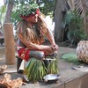 Ali'i Tour: Straining cocnut juice with the coconut hull.