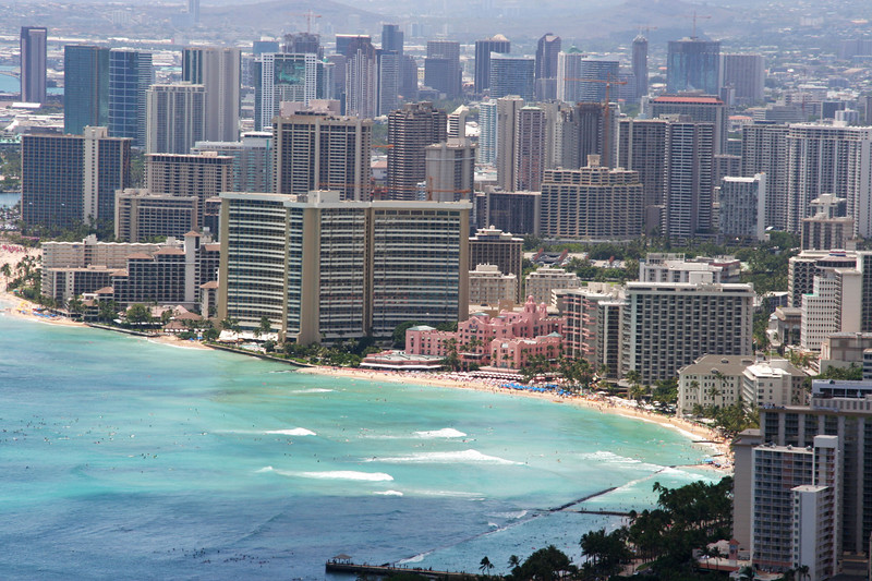 "The ""Pink Hotel"", (<a href=""http://www.fivestaralliance.com/luxury_hotel/honolulu,_hi/the_royal_hawaiian?gclid=CIze6qPP-40CFQ2aOAodxFfcOA""><span style=""color:#388E8E;"">the Royal Hawaiian Sheraton</span></a>), which is next door to Duke's.  Interested? Click <a href=""http://www.royal-hawaiian.com/rr_2007.htm""><span style=""color:#388E8E;"">here</span></a> for rates.   Check out the people in the surf  in this photo."