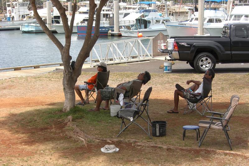 Hawaiian dudes, fishing.  Hawaiian style
