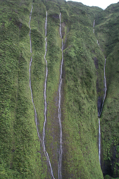 Wai'ale'ale Crater, the wettest spot on earth, with its 3000 ft waterfalls.  The helicopter flew right up to the 3000 ft wall.