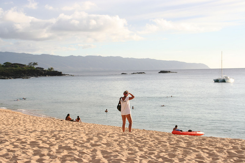 Waimea Bay.  Becky scouting for a good place to settle down.