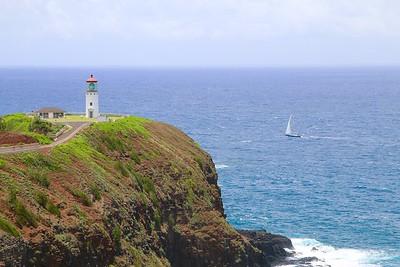 Sailing past Kilauea Lighthouse @ Kilauea Point. Kaua'i, Hawaii, USA.