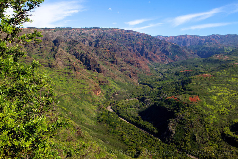 The Waimea River winds down through Waimea Canyon on Kauai. Waimea is Hawaiian for red water, referring to the beautiful color of soil in Waimea Canyon.
