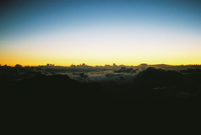 Dawn breaking over the clouds at the Haleakala Crater