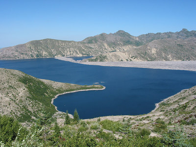 Spirit Lake, Mount St Helens.  This area was compltely covered in forest before the eruption, and those are dead trees from the devastated forest floating on the lake.  These trees move around the lake in the wind.