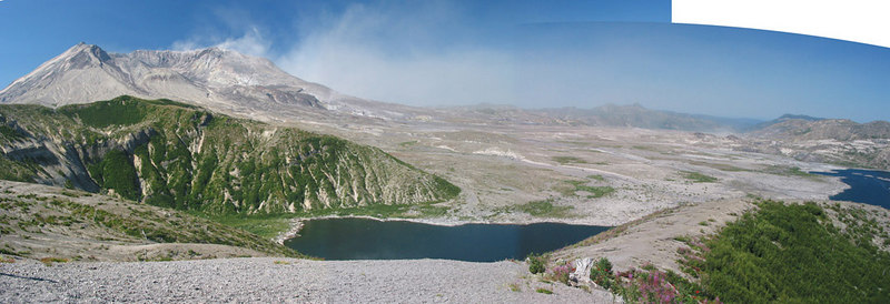 A panorama from Windy Ridge Viewpoint showing the collapsed side of Mount St Helens down towards Spirit Lake (the water on the far right).  All this area was covered in pristine native forest before the eruption.