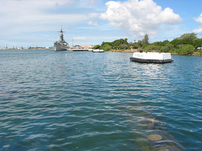 Looking from the USS Arizona memorial towards the USS Missouri.  That's the remains of the USS Arizona in the water (bottom right).  The memorial is built on top of the sunken battleship.