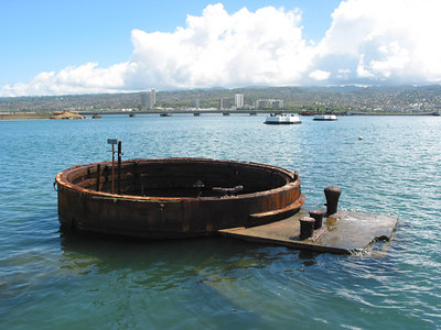 Looking over the sunken USS Arizona from the memorial towards the mainland (and some nice developing TCu as well!)