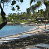 Kona Resort is located on a bay with lava rock and sandy beach.  The Pacific water is very clear.