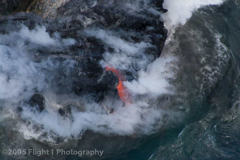Lava entering the ocean from a helicopter perspective