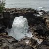A sea arch cut into the lava.