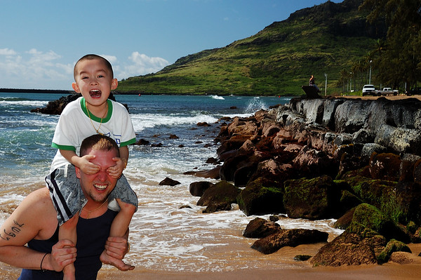 Dominick on Jeff's shoulders at Kalapaki Beach.  Nawiliwili,Kauai, Hawaii