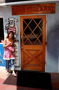 Sam in front of a bar in Kona