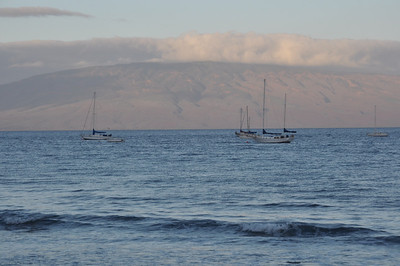 boats in harbor with island of Lanai in background