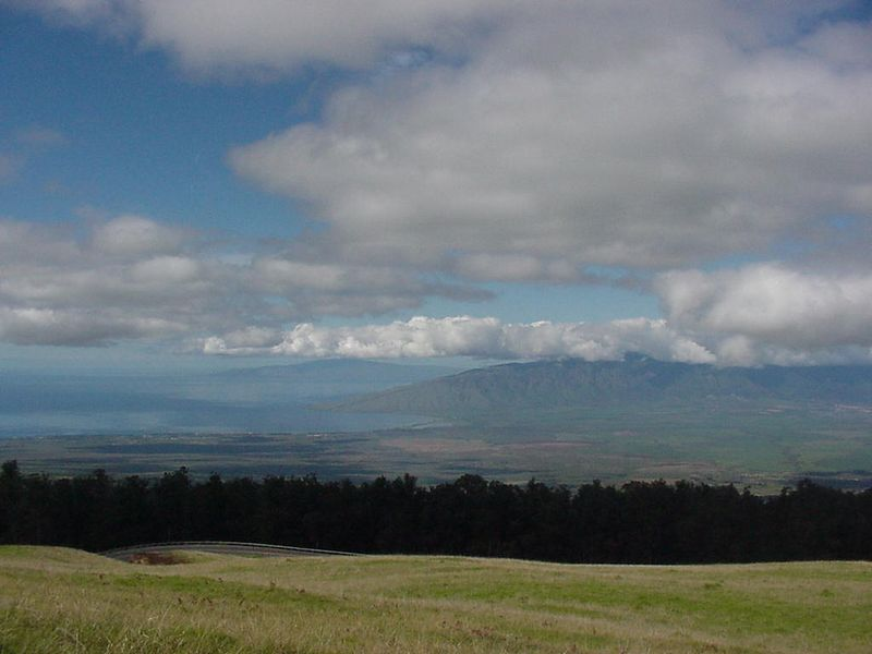 We have started our drive up to the Haleakala crater. West Maui Mountains are below clouds with Lanai on distant horizon.