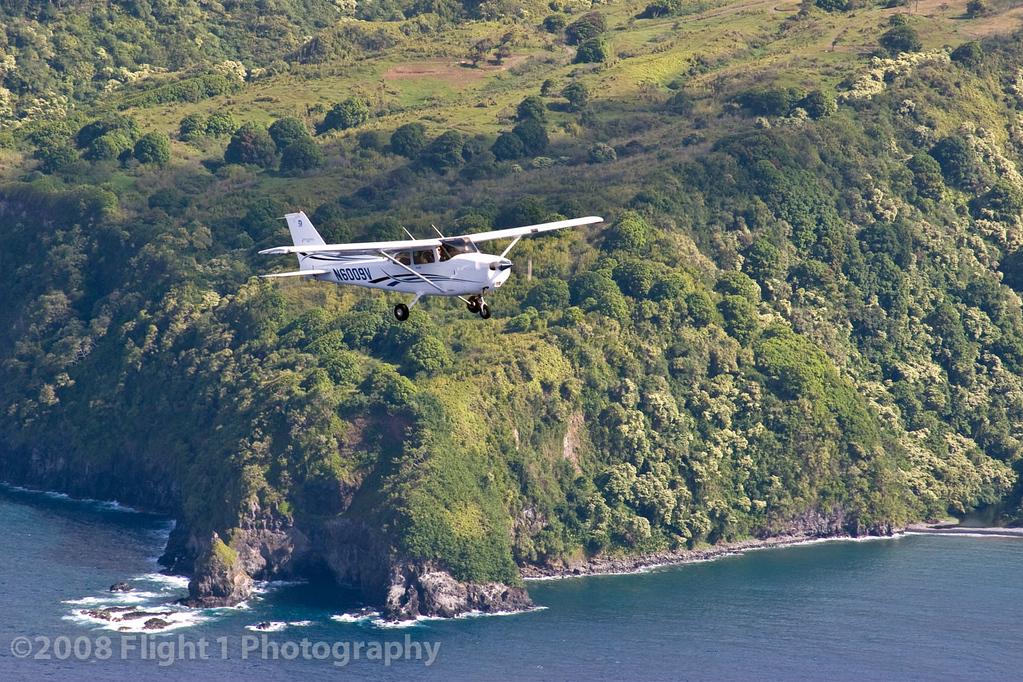 Maui Aviators Cessna 172 against the Maui coastline during photo shoot for Pilot Journal magazine
