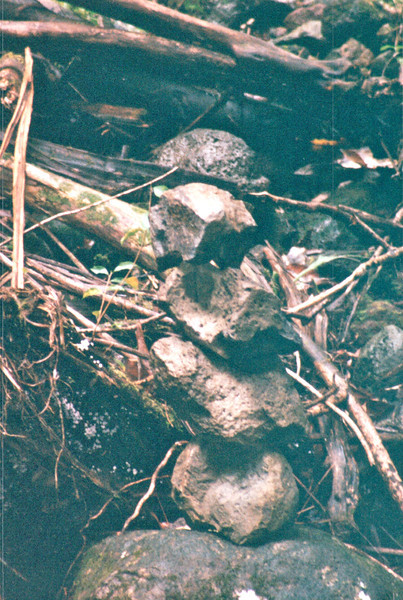 A Pile of Stones Across From the Falls - Honolulu, O'ahu, Hawaii - April 23-29, 2003<br /> Wonder what meaning the person meant in placing them there.