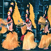 Hula Dancers - Nature's Sunshine's Closing Luau - Hilton Hawaiian Village - Honolulu, O'ahu, Hawaii - April 23-29, 2003<br /> Hula was originally performed mostly by men in secret religious ceremonies.  Accompanied by drums and chants, it was a dance of warriors and nobility.  But in the early 19th century it began to change, becoming more secular and opening to the participation of women and commoners.