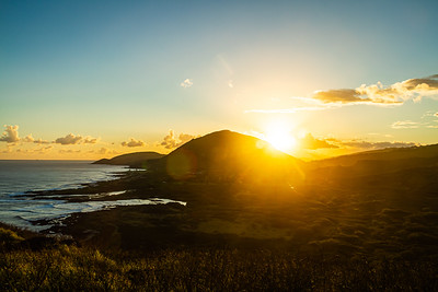 A sunset from high above the Hawaiian island of Oahu with Koko Head crater in the distance