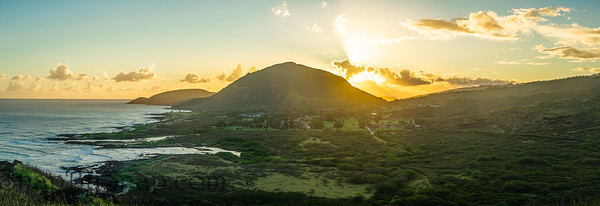 A panoramic sunset from high above the Hawaiian island of Oahu with Koko Head crater in the distance