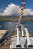The USS Missouri watches over the USS Arizona in her final resting place along Battleship Row in Pearl Harbor