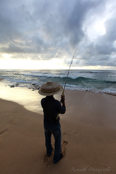 Fishing in the surf.