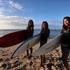 Mai and her friends pose for photos before paddling out to catch the early waves.