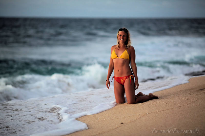 A German tourist poses on the sand.