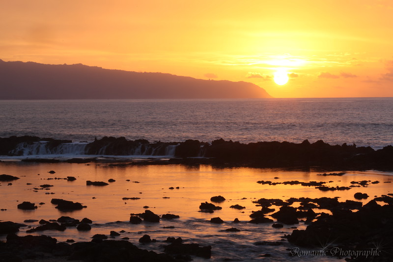 Sunset over Shark Cove on the north shore.