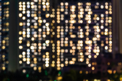 Background image of the blurred-out lights of a building