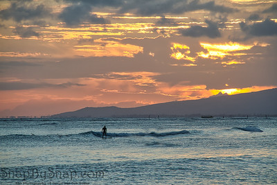Solo Surfing at Sunset