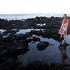 Kennedy watches the sun rise from the reef at Poipu Beach Park.