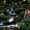 "A holidaying couple soak their feet in the ""cold pool"" stream."