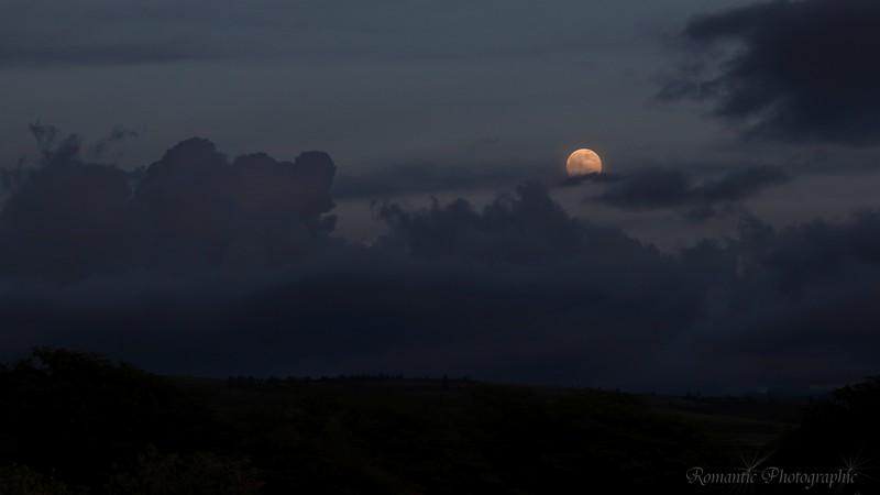 As the sun sets, the moon comes up on Kekaha Beach Park