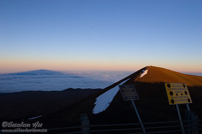 Mauna Kea's highest point on the right, and to the left is the shadow cast by Mauna Kea at sunset.  The shadow stretches for about 100 miles long!
