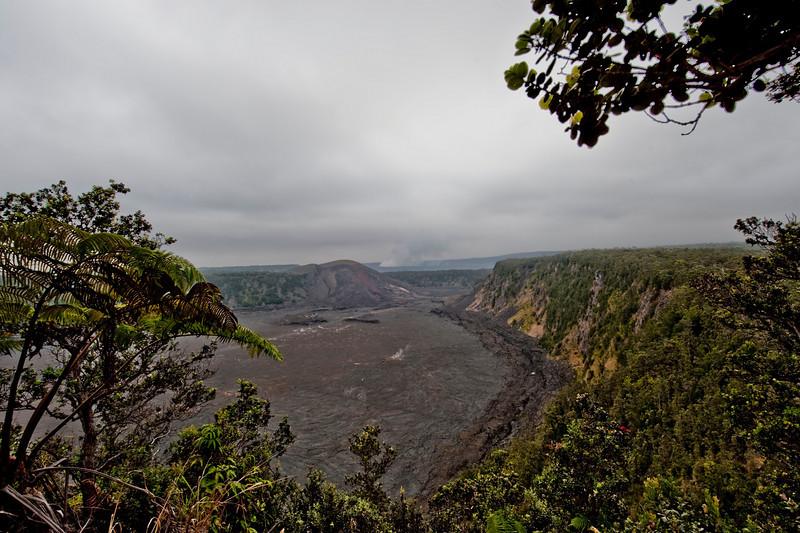 Standing in Kilauea Caldera at Hawai'i Volcano National Park. Halema'uma'u Crater in the distance