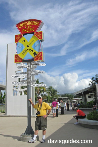 Ren beneath sign at Valor in the Pacific National Memorial, Pearl Harbor